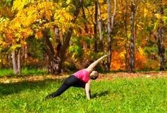 Yoga parivrita parshvakonasana pose Stock Images