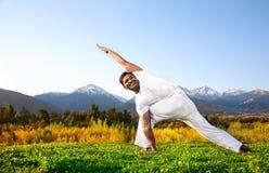 Yoga parivrita parsvakonasana Stock Image