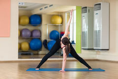 Yoga Parivrtta Trikonasana, Revolved Triangle Pose Royalty Free Stock Image