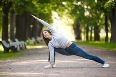 Yoga on park alley Stock Photos