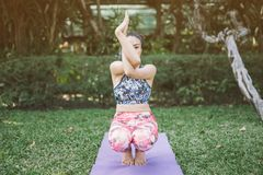 Yoga in the park healthy exercise. stock photos