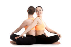 Yoga with partner, Easy (Decent, Pleasant Pose), Sukhasana Royalty Free Stock Photo