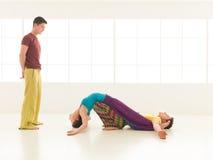 Yoga partner gym vibrant color Stock Photos