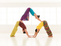 Yoga partner gym vibrant color Royalty Free Stock Photography