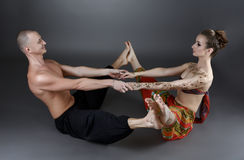 Yoga with partner. Trainers show one of asanas Stock Photography