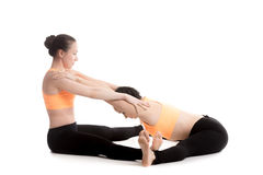 Yoga with partner, Wide-Angle Seated Forward Bend Pose Royalty Free Stock Photos