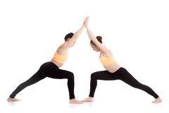 Yoga partnering, Virabhadrasana 1 pose Royalty Free Stock Image