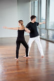 Yoga Partners Exercising At Gym Stock Photo