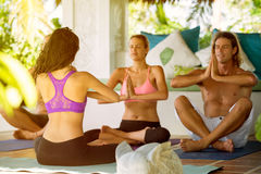 Yoga people in a class meditating Royalty Free Stock Photography
