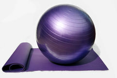 Yoga and pilates. Yoga mat and pilates conditioning ball Royalty Free Illustration