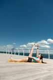 Yoga. Pose anantasana against the sea Royalty Free Stock Photography
