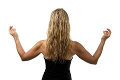 Yoga pose, back of blond woman standing. Yoga pose, back of blond woman in black outfit standing hands appart Royalty Free Stock Photos