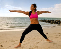 Yoga pose in the beach Royalty Free Stock Photography