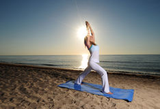 Yoga pose on beach Stock Photo