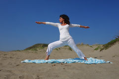 Yoga pose at the beach Stock Photography