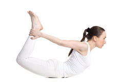 Yoga pose dhanurasana Stock Image