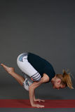 Yoga pose female in sport clothes doing exercise Stock Photography
