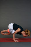Yoga pose female in sport clothes doing exercise Royalty Free Stock Photos