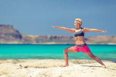 Yoga pose, fit woman exercise on beach Royalty Free Stock Images
