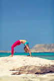 Yoga pose, fit woman exercise on beach Royalty Free Stock Photos
