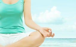 Yoga pose hand close up over sky Stock Photos