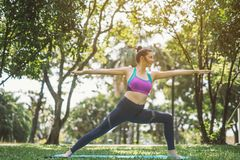 Yoga pose in nature park royalty free stock images
