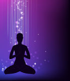 Yoga pose - padmasana. Silhouette of a man sitting in a lotus pose Royalty Free Stock Images