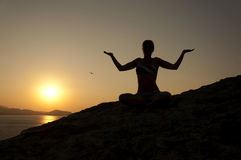 Yoga pose silhouette at sunrise Royalty Free Stock Image