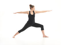 Yoga pose variation, demonstrated by young female instructor Stock Image