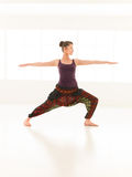 Yoga pose variation, demonstrated by young female instructor Stock Images