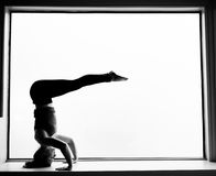 Yoga Pose in on windowsill Stock Image