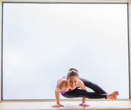 Yoga Pose in on windowsill Royalty Free Stock Image