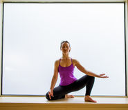 Yoga Pose in on windowsill Stock Photography