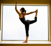 Yoga Pose in on windowsill Royalty Free Stock Photos