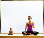 Yoga Pose in on windowsill Royalty Free Stock Images