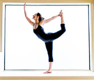 Yoga Pose in on windowsill (Natarajasana) Stock Photography