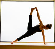 Yoga Pose in on windowsill Royalty Free Stock Photography