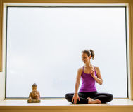 Yoga Pose in on windowsill Stock Photos