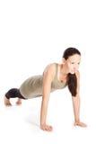 Yoga poserar i studio Arkivbild