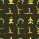 Yoga poses background. Female silhouettes in poses of hatha yoga. Seamless pattern Stock Photo