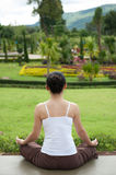 Yoga posing in garden Royalty Free Stock Images