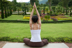 Yoga posing in garden Stock Photography