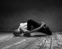 Yoga posing in loft studio Royalty Free Stock Photos