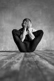 Yoga posing in loft studio Royalty Free Stock Images