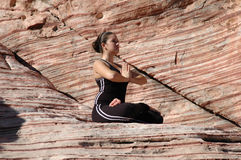 Yoga Position. A girl doing yoga in Red Rock Canyon, Las Vegas Nevada Royalty Free Stock Photo