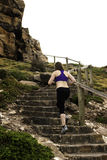 Running up steps woman athlete female Royalty Free Stock Image