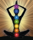 Yoga position. Woman silhouette in yoga position with the symbols of seven chakras Stock Photo