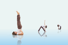 Yoga positions. A yoga teacher with three different positions on a blue gradient ground Royalty Free Stock Image