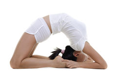 Yoga Posture. Woman in yoga, Pigeon Posture (Kapotasana), on white background royalty free stock images