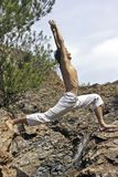 Yoga posture on the rocks Stock Photo